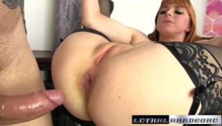 Russian Porn Video - A redhead in black stockings planted the point on the thick penis of the partner