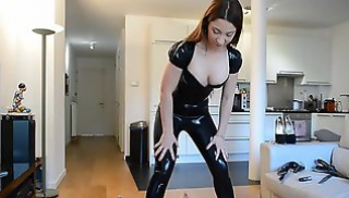 Porn Zab - A brunette in a latex outfit takes a dude's cock in her mouth in front of the camera