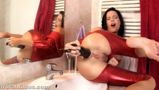 Russian Sex - A brunette in a red bodystocking Fucks a point with a Dildo in front of the mirror