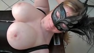 Russian Pornography - Busty mother in a mask sucks off a roommate during Masturbation