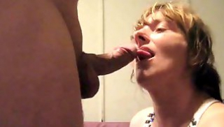 Russian Sex - Granny in a t-shirt kneels in front of the erect member and takes it in her mouth