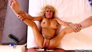 Russian Porn Online - Old woman with big Tits sucks a man's cock and gives it in the ass on the bed