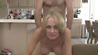 Russian Porn Download - A blonde with slender legs and elastic Tits lay down on the bed and had sex with her lover