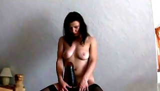 Russian Porn - Milf in boots shines with her Breasts and settles her vagina on a big Dildo