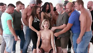 Russian Sex Video - A crowd of men jerks off and cums on face and Tits young girls in stockings